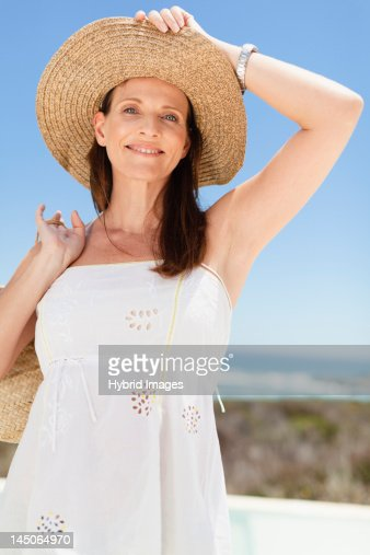 Woman Wearing Straw Hat Outdoors Stock Photo