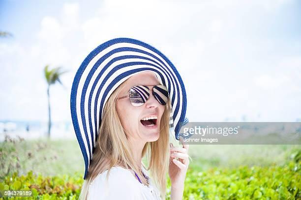 Woman wearing sunhat laughing