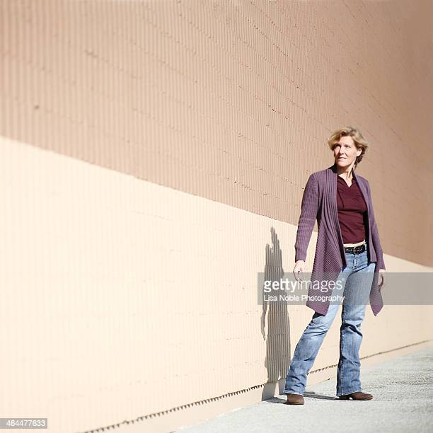 Woman wearing sweater-jacket and blue jeans
