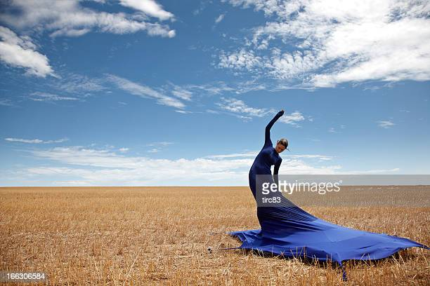 Woman wearing tent dress in cornfield