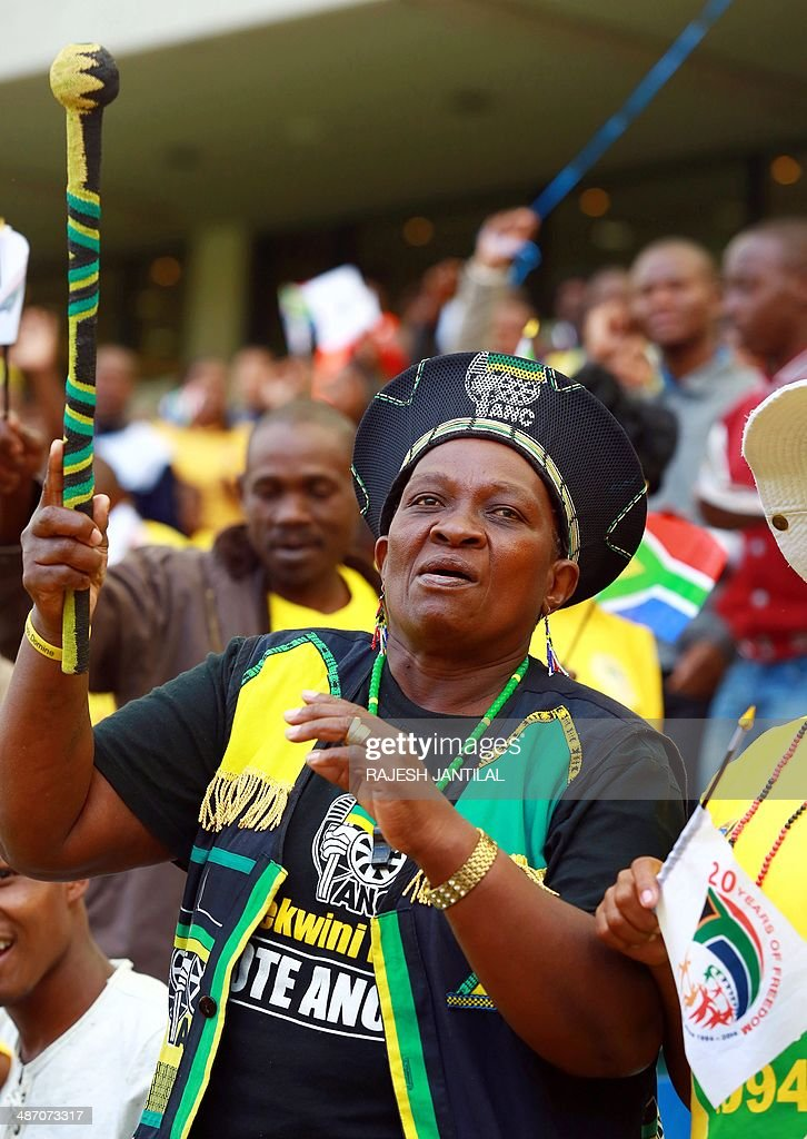 A woman wearing the colors of the South African Ruling party African National Congress takes part in the 20th Freedom Day celebrations at the Moses Mabhida Football stadium in Durban on April 27,2014. Freedom Day celebrations mark the 20th anniversary of the country's first democratic elections in the post-Apartheid era.