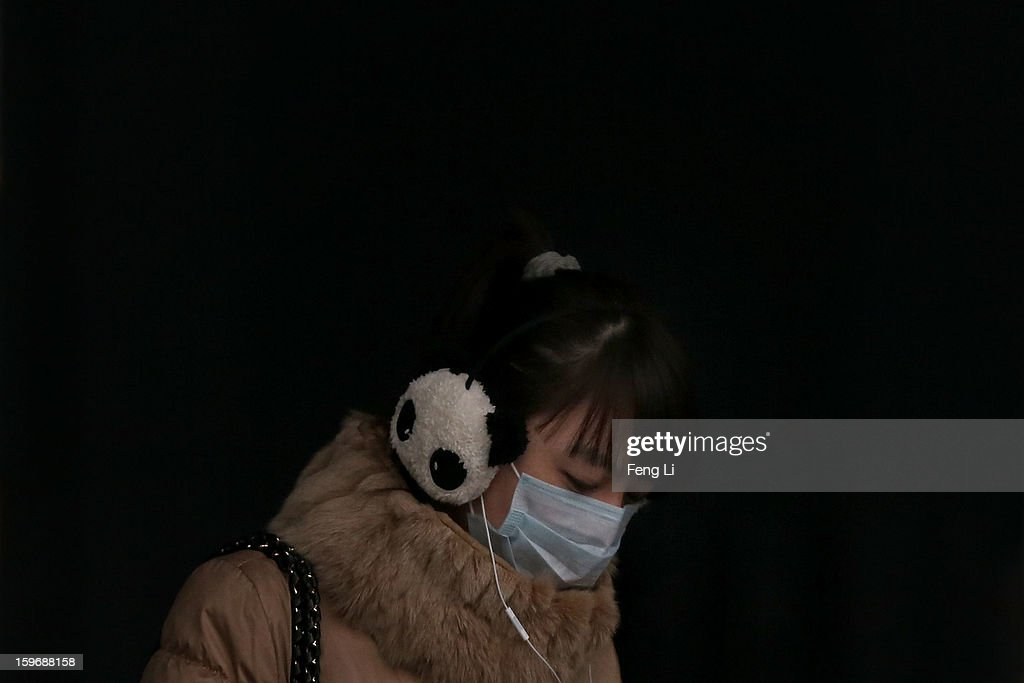 A woman wearing the mask walks on the street during severe pollution on January 18, 2013 in Beijing, China.