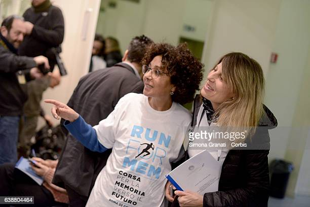 A woman wearing the shirt of the Marathon of Memory together with the marathon runner Franca Fiacconi during a press conference at Palazzo Chigi for...