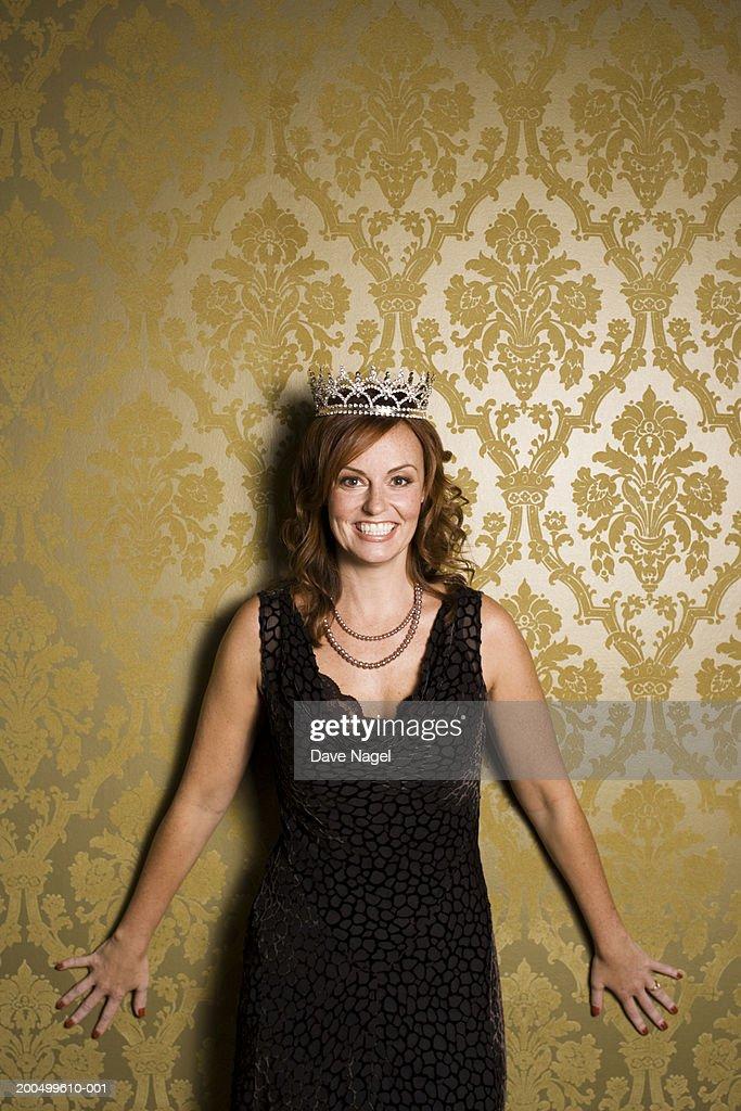 Woman wearing tiarra, smiling, portrait : Stock Photo