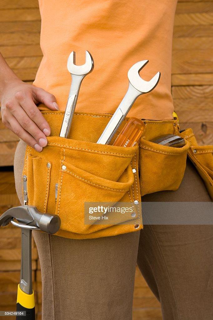 Woman Wearing Tool Belt