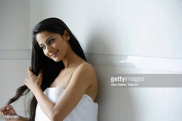 woman wearing towel, touching hair