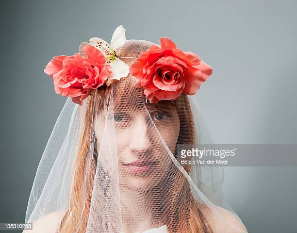 woman wearing veil with flowers.