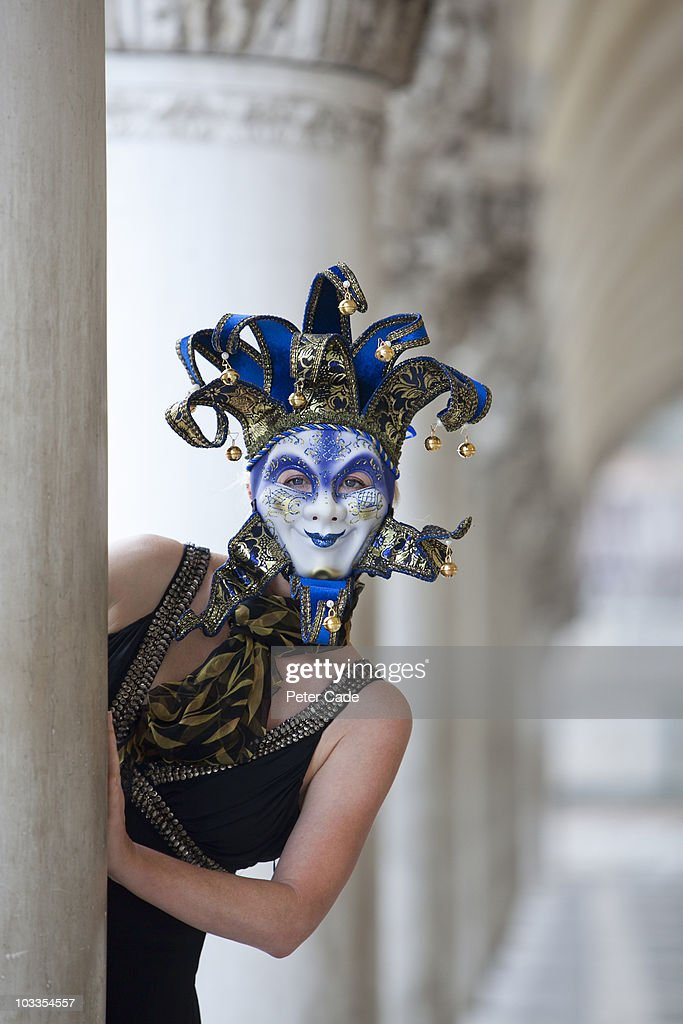 woman wearing venician mask in St Marks Square : Stock Photo