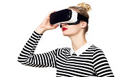 Attractive woman wearing virtual reality glasses. VR headset. Virtual reality concept on white background.