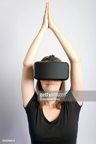 Woman Wearing Virtual Reality Headset Doing Yoga