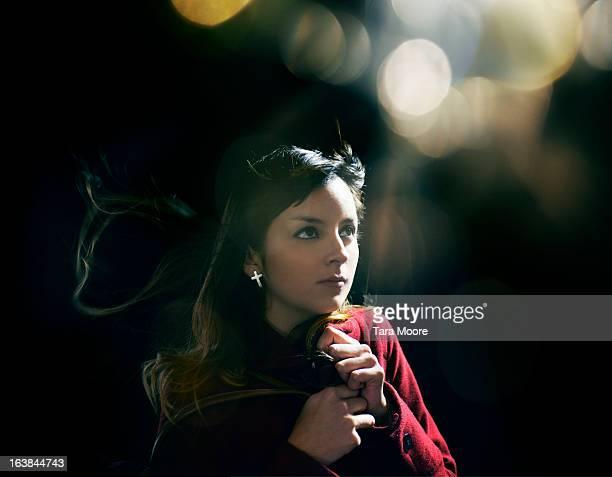 woman wearing warm coat at night