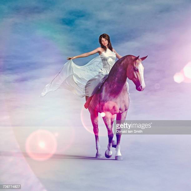 Woman wearing white dress riding horse