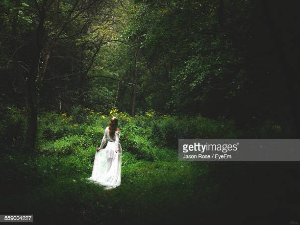 Woman Wearing White Dress Standing In Forest