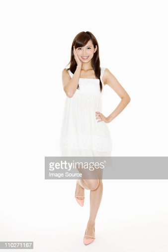 Woman wearing white sundress, studio shot