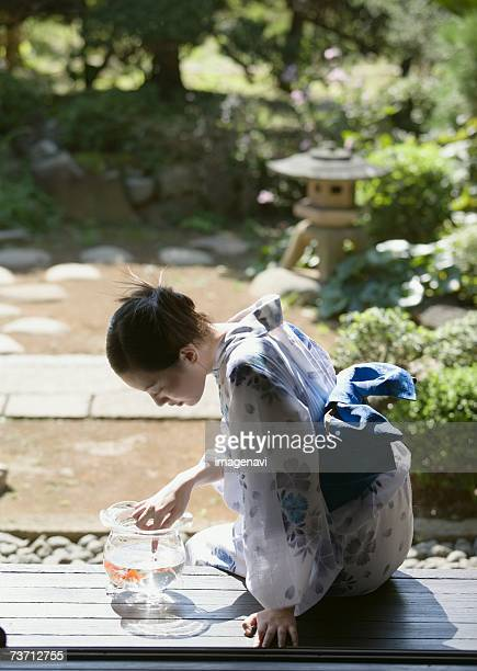 Woman wearing Yukata and fishbowl