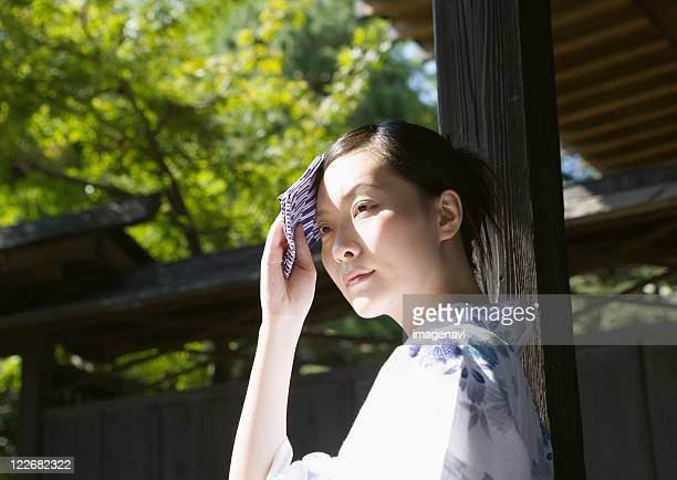 Woman wearing Yukata with hand towel