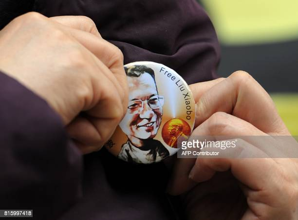 A woman wears a badge asking for the release of mainland jailed dissident Liu Xiaobo outside the legislative council in Hong Kong on December 8 2010...