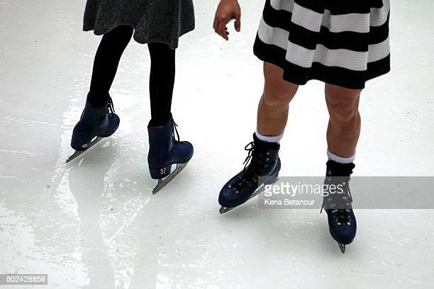 A woman wears a dress while ice skating at the rink at Rockefeller Center on December 24 2015 in New York City New York City has seen highs in the...