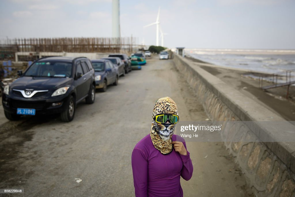A woman wears a face-kini in Qidong Golden Beach during the 3rd Qidong YuanTuoJiao Kite Surfing Invitational Tournament on October 6, 2017 in Nantong, Jiangsu Province ,China.