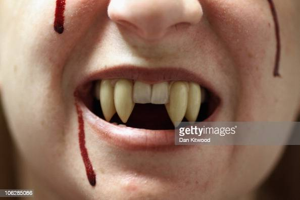 A woman wears a fake pair of fangs at Angels Fancy Dress on October 28 2010 in London England The world famous costume shop is having one of its...