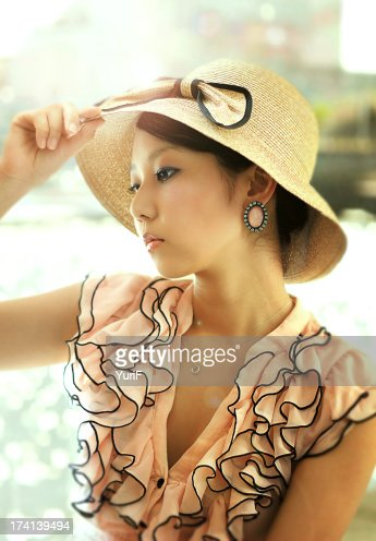 Woman wears a hat. : Stock Photo
