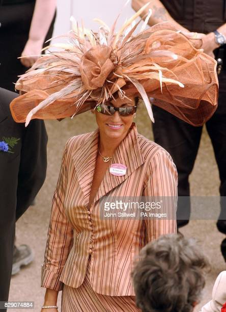 A woman wears a large floral hat in the Royal Enclosure during Ladies Day at Royal Ascot in Berkshire Crowds of racegoers were gathering for what is...