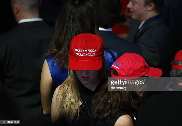 A woman wears a 'Make America Great Again' hat during an election night party for 2016 Republican Presidential Nominee Donald Trump at the Hilton...