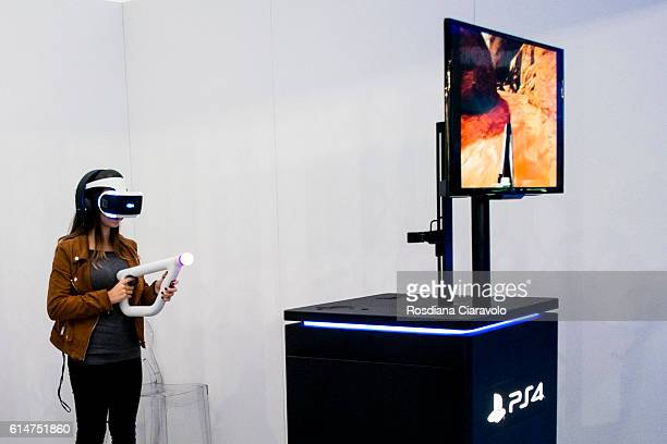 A woman wears a PlayStation VR headset developed by Sony Interactive Entertainment during the Milan Games Week 2016 on October 14 2016 in Milan Italy