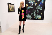 A woman wears a POP dress during the VIP opening of The Armory Show 2016 in New York March 2 2016 / AFP / Timothy A CLARY / RESTRICTED TO EDITORIAL...