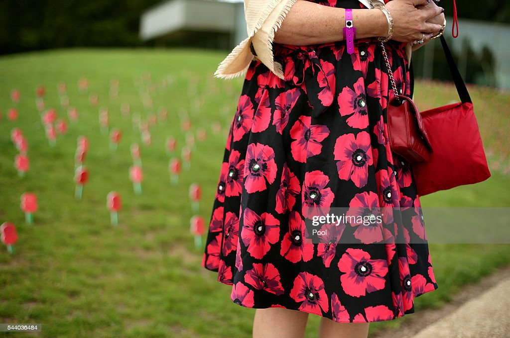 A woman wears a poppy dress, ahead of the 100th anniversary of the beginning of the Battle of the Somme at the Thiepval memorial to the Missing on July 1, 2016 in Thiepval, France. The event is part of the Commemoration of the Centenary of the Battle of the Somme at the Commonwealth War Graves Commission Thiepval Memorial in Thiepval, France, where 70,000 British and Commonwealth soldiers with no known grave are commemorated.