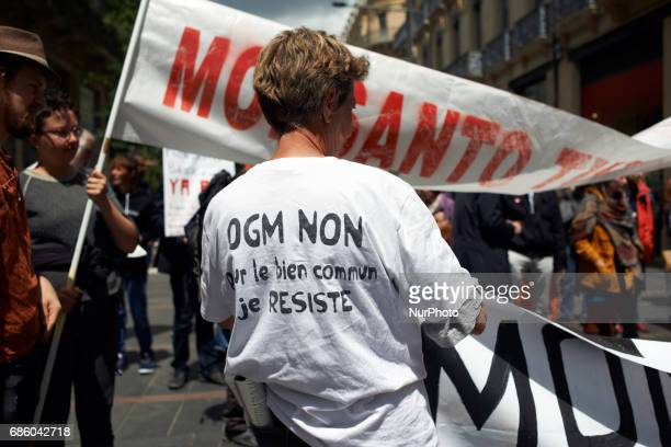 A woman wears a shirt with the inscription 'No to GMO for the common good I resist' People march in Toulouse for the International March against...