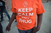 A woman wears a tshirt with a message calling for calm near Pennsylvania and West North avenues in West Baltimore on May 4 2015 Police deployed in...