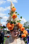 A woman wears an elaborate hat of orange roses and ivy during Ladies Day at Royal Ascot racecourse on June 19 2008 in Ascot England