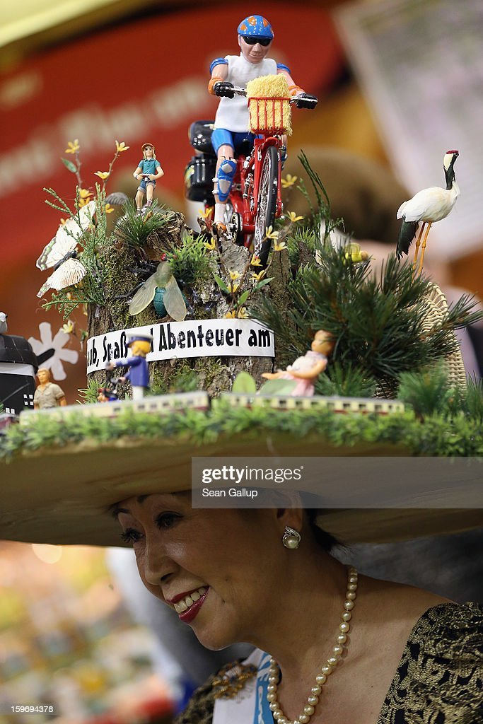 A woman wears an elaborate hat to promote Mecklenburg-Western Pomerania at the 2013 Gruene Woche agricultural trade fair on January 18, 2013 in Berlin, Germany. The Gruene Woche, which is the world's largest agricultural trade fair, runs from January 18-27, and this year's partner country is Holland.