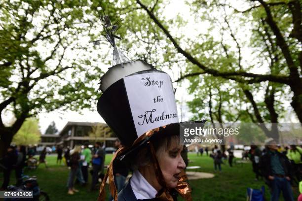 A woman wears an oil rig on her head during the People's Climate March in Portland Ore United States on April 29 2017 Thousands turned out in...