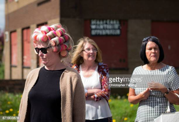 A woman wears curlers as families and local residents watch the Manchester St George's Day parade through the streets on April 23 2017 in Manchester...