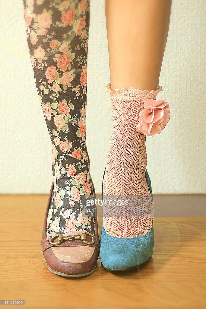 Woman wears different socks on each leg : Stock-Foto
