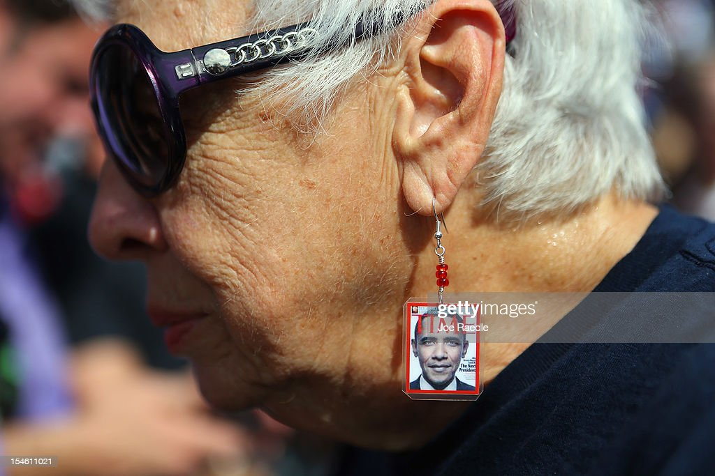 A woman wears earrings with a picture of U.S. President Barack Obama as he speaks during a campaign rally at the Delray Beach Tennis Center on October 23, 2012 in Delray Beach, Florida. Obama continues to campaign across the U.S. in the run-up to the November 6, presidential election.
