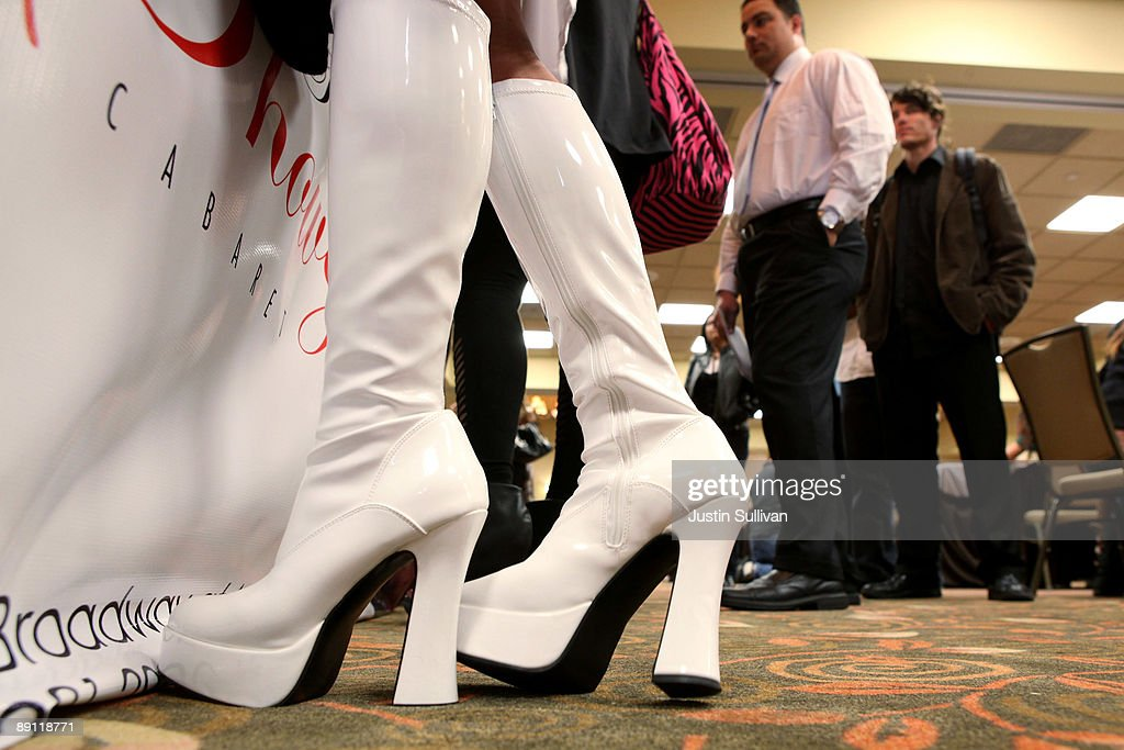 A woman wears platform go-go boots as she talks with managers at the Showgirls booth during a job fair for the adult entertainment industry July 20, 2009 in San Francisco, California. Hundreds of job seekers attended a job fair that featured eleven San Francisco strip clubs offering jobs ranging from bartender and cashiers to exotic dancers and waitresses.