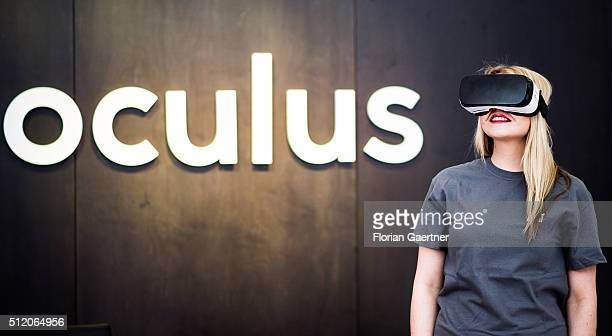 A woman wears the HeadMounted Display Oculus Rift on February 24 2016 in Berlin Germany Facebook presented its Innovation Hub where new technology...