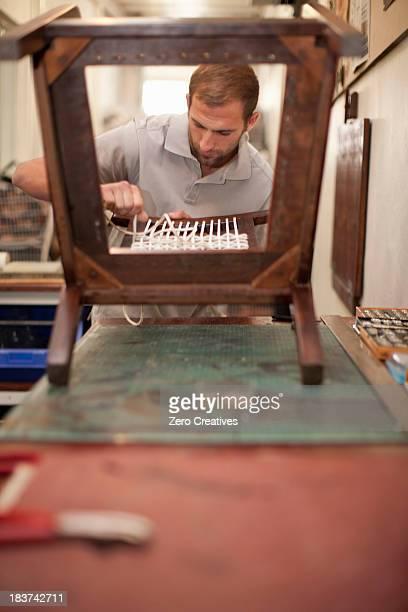 Woman weaving chair back