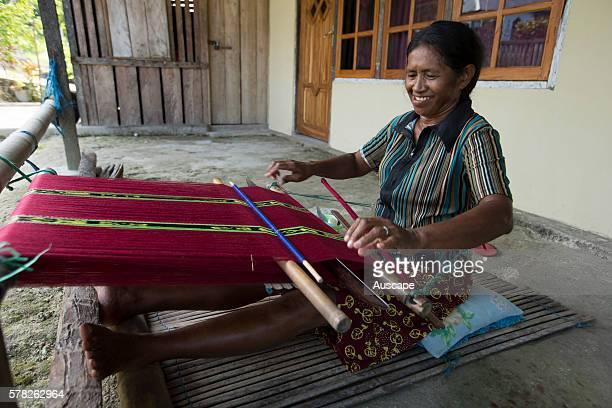 A woman weaving ikat cloth at an oldstyle loom Sangliat Dol village Yamdena island Tanimbar archipelago Maluku Indonesia