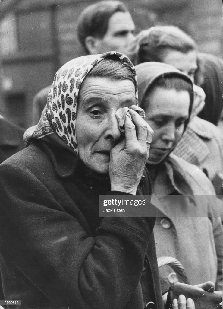 A woman weeping as she watches Russian action against the Hungarian anti-communist uprising. Original Publication: Picture Post - 8730 - Hungary's Last Battle for Freedom - pub. 1956