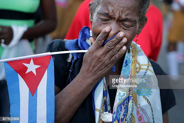 A woman weeps after watching a military convoy transport the remains of former Cuban President Fidel Castro from Revolution Plaza to the Cementerio...