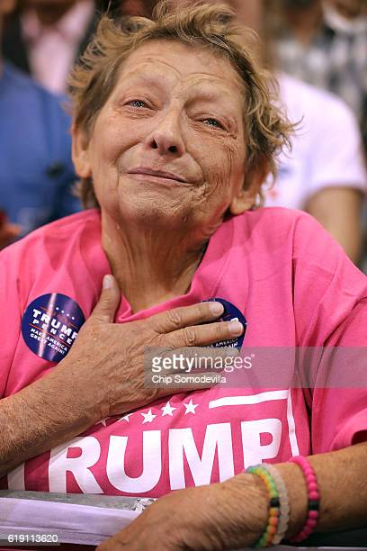 A woman weeps as she listens to Republican presidential nominee Donald Trump address a campaign rally at the Phoenix Convention Center his seventh...