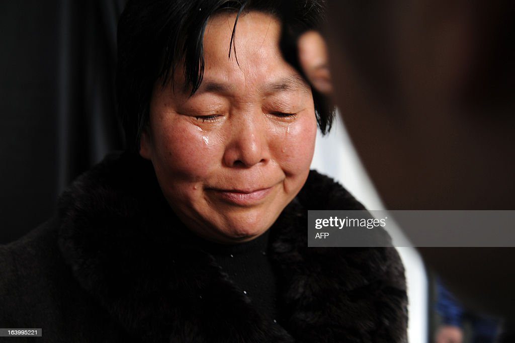 A woman weeps as she mourns for Wu Renbao, the former secretary of Huaxi Village Communist Party Committee, at his home in Huaxi Village, east China's Jiangsu Province on March 19, 2013, after the 85-year-old cadre died from lung cancer on March 18. Foungded in 1961, Huaxi Village claims itself to be the richest village in China and calls itself a model socialist village. CHINA