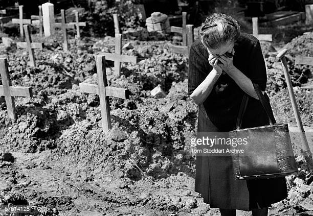 A woman weeps in the Lion Cemetery where Sarajevo citizens were buried during the siege of the city between 1992 and 1996