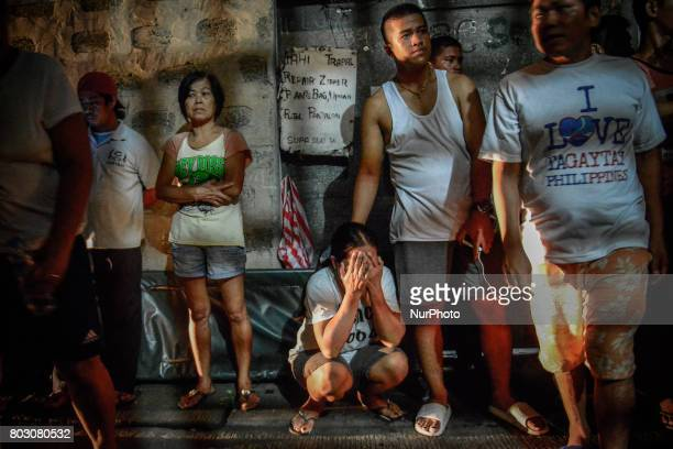 A woman weeps near the scene where a suspected drug user was shot dead by unknown assailants in Navotas north of Manila Philippines June 19 2017...