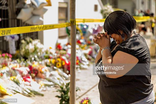 A woman weeps outside the historic Emanuel African Methodist Episcopal Church June 19 2015 in Charleston South Carolina Authorities arrested Dylann...