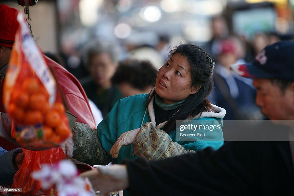 A woman weighs produce at a market on March 17, 2009 in New York City. The Labor Department reported Tuesday a big decline in food prices. Food costs have now fallen for three straight months, declining 1.6 percent in February, the biggest one-month decline in three years.